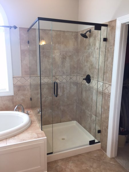 Frameless Heavy Glass Panel, door, Panel with 90 degree return installed with header, clamps and pivot hardware Oil Rub Bronze-clear