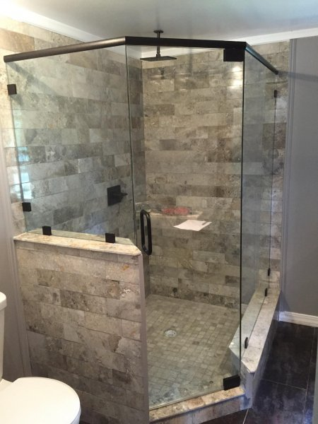 Frameless Heavy glass Neo Angle shower with Header Pivot door, Panels installed with clamps