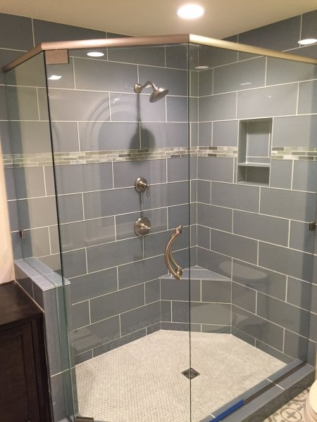 Frameless Heavy glass Neo Angle Shower with header, pivot door and panels installed with clamps & Concerto Curved handle