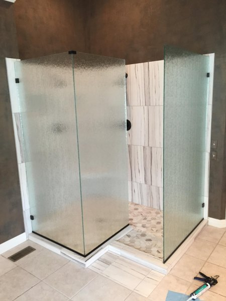 Frameless Heavy glass Cast- installed with channel and clamps