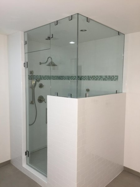 Frameless Heavy glass door & panel with 90 degree Steam shower with transom installed with clamps