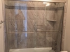 Semiframeless Euro Sliding on tub Brushed Nickel-Clear with 2 towel bars.