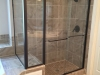 Semiframeless Euro Sliding with inline and 90 degree panels Oil Rub bronze Clear with 2 towel bars