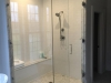 Frameless Heavy Glass Door & Panel with 90 degree Panel installed with channel and clamps, Symphony handle