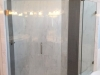 Frameless Heavy Glass door & Panel with notched panel and return panel Brushed Nicle-Clear. Panels installed with clamps