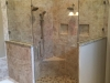 Frameless Heavy Glass Neo Angle Shower with Header, pivot door and panels installed with clamps