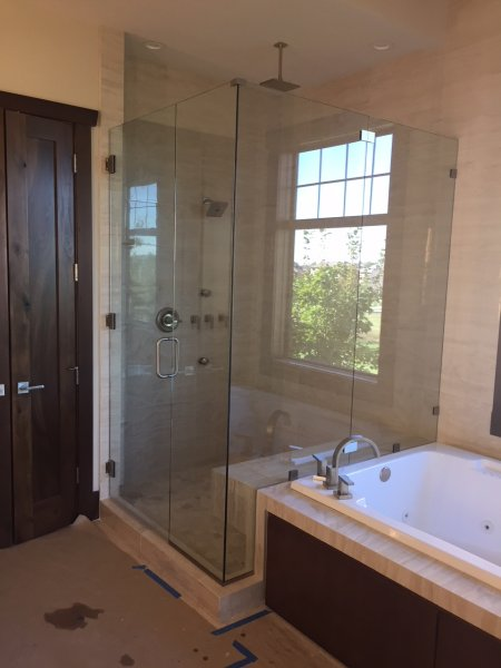Frameless Heavy Glass Door & Panel with 2- 90 degree panel joined together inline with clamps installed with clamps and channel brushed Nickel-Clear