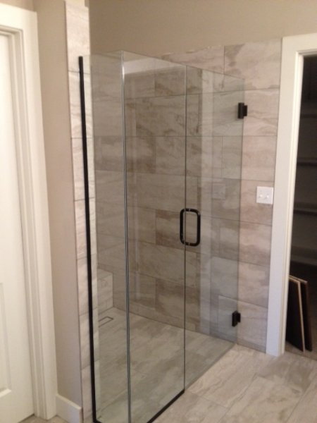Frameless Heavy Glass Door & Panel with 90 degree return installed with channel and no curb ORB-Clear