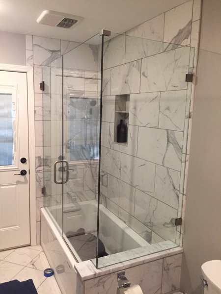 Frameless Heavy glass door & Panel with 90 on tub panel installed with clamps Brushed Nickel-Clear