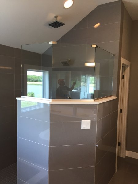 Frameless Heavy Glass Panels installed with bottom channel and top clamps