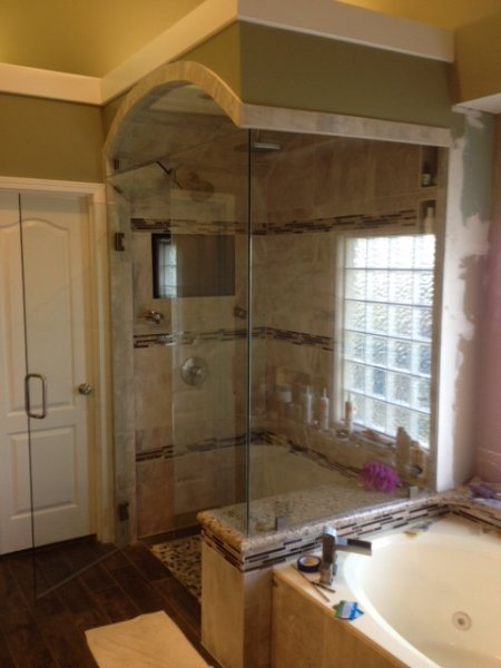 Frameless Heavy Glass Door & Panel with 90 degree return with operating transom and stationary 2