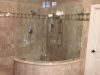 Frameless Bent heavy glass Shower Panel installed with Clamps