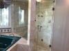 Frameless Heavy Glass Door & Panel with operating Transom. and Large Shower Panel installed with clamps
