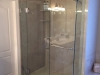 Frameless Heavy Glass Panel, door, Panel with 90 degree return, large clamps with no header and towel bar